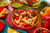 image of nachos  - Chicken fajitas with mexican food guacamole pico de gallo chili peppers sauce and nachos - JPG