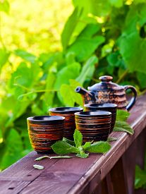picture of peppermint  - small cups with peppermint tea in garden - JPG