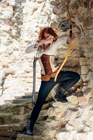 foto of bow arrow  - Ancient female archer with bow and arrow  - JPG