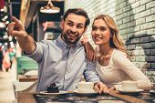 Couple Drinking Coffee poster