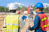 Construction Engineer Hodling Construction Drawing And Smart Tablet With Foreman Worker Checking Con poster