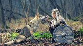 Viking Woman Warrior With Braided Hair Holding Shield Close To Wild Wolf In Forest - Outdoor Warrior poster