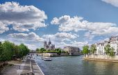 Panorama With Notre Dame Cathedral And Boat On Seine In Paris, France poster