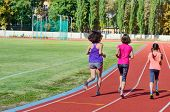 Family Sport And Fitness, Happy Mother And Kids Running On Stadium Track Outdoors, Children Healthy  poster