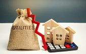 Money Bag With The Word Utilities And An Arrow Down And Wooden Houses On The Calculator. Reduced Pri poster