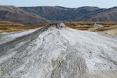 Landscape Of Two Mud Volcanoes With Hills Beyond Them, Berca, Romania. poster