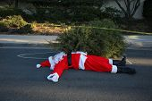 Los Angeles Crime Scene.  Santa Claus lays dead on the ground with a Police Chalk Line and Sheriff D poster