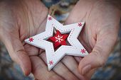 Handcrafted Wooden Christmas Stars. Love And Tenderness Between Elderly People. poster