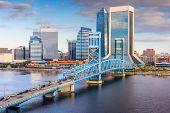 Jacksonville, Florida, USA downtown skyline at dusk over St. Johns River.  poster