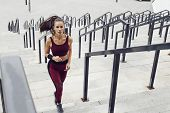 Fitness Sporty Woman During Outdoor Exercises Workout. Beautiful Fit Girl Running Up Stairs. Fitness poster
