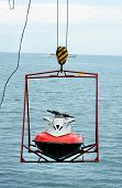 picture of ski-doo  - jet ski lift for dry storage on the sea background - JPG