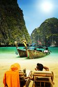 Couple relaxing Maya bay Phi Phi Leh island, Thailand