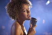picture of singer  - Closeup of a female jazz singer on stage - JPG