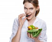 seductive european woman & vegetable salad - isolated on white background