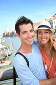 stock photo of academia  - Couple standing on the Academia Bridge in Venice - JPG