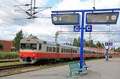 pic of railcar  - Regional train on an empty platform at a railway station - JPG