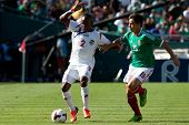 PASADENA, CA - JULY 7: Leonel Parris #2 of Panama and Efrain Velarde #15 of Mexico during the 2013 C