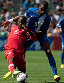 PASADENA, CA - JULY 7: Julian De Guzman #6 of Canada and Frederic Piquionne #9 of Martinique during