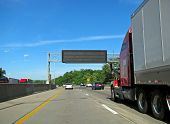 foto of big-rig  - big semi trailer truck driving on highway - JPG