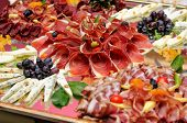 picture of banquet  - Table full of meat and cheese focus on prosciutto - JPG
