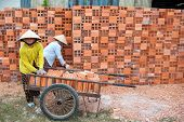 Vietnamese women working in a brickyard