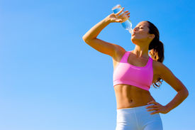 picture of athletic woman  - Athletic woman working out in a meadow from a complete series of photos - JPG