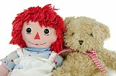 stock photo of rag-doll  - Old rag doll with brown teddy bear isolated on white - JPG