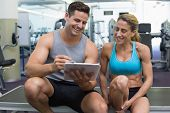 picture of personal care  - Female bodybuilder sitting with personal trainer talking at the gym - JPG