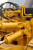 foto of hydraulics  - Hydraulic hoses and pistons of a modern tractor - JPG