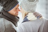 picture of cold-shoulder  - Couple in warm clothing facing each other on a cold day in the city - JPG