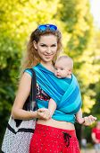 picture of sling bag  - Young mother and baby in a sling - JPG