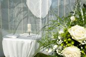 picture of reception-area  - White wedding reception decoration with bouquet with roses - JPG
