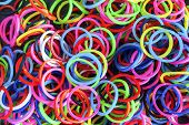 stock photo of rubber band  - Colorful background Rainbow loom rubber bands fashion - JPG