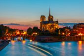 pic of notre dame  - The southern facade of Cathedral of Notre Dame de Paris at sunset - JPG
