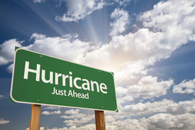 picture of hurricane wind  - Hurricane Green Road Sign with Dramatic Clouds and Sky - JPG