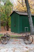 stock photo of wagon wheel  - Vintage horse drawn iron wheel wagon on an old farm - JPG