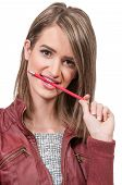 image of midterm  - Beautiful woman college student chewing on a pencil - JPG