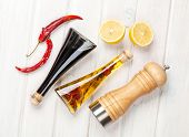 pic of condiment  - Condiments and spices over white wooden table - JPG
