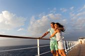 foto of married couple  - loving married couple standing on cruise deck enjoying sunset together - JPG