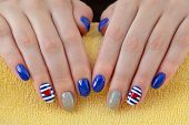 foto of nail paint  - Finger nail treatment hands with painted fingernails - JPG