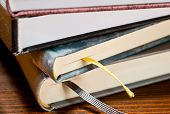 stock photo of scriptures  - a detail of books in the bookshelf - JPG