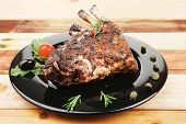 stock photo of ribs  - grilled ribs on wooden table with pomegranate seeds - JPG