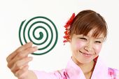 foto of coil  - Young woman wearing Japanese kimono with mosquito coil - JPG