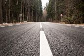 foto of twisty  - Highway passing through the autumn forest in psamurnuyu weather - JPG