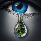 picture of seasonal  - Holiday depression and winter season anxiety and emotional crisis concept as a human eyeball crying a tear with a christmas tree inside as a metaphor for seasonal sadness - JPG