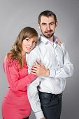 picture of friendship belt  - Young embracing couple in love posing at studiot - JPG