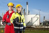 image of personal safety  - Two safety specialists monitoring the perimeter of a petrochemical refinary - JPG