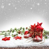 image of nostalgic  - nostalgic christmas decoration with antique baby shoes - JPG