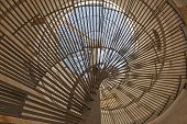 picture of spiral staircase  - Abstract closeup view through metal spiral staircase - JPG