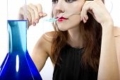 stock photo of inhalant  - woman inhaling flavored oxygen with cannula and scented water - JPG